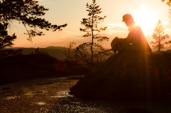 my-brother-on-a-rock-in-sunset-glow
