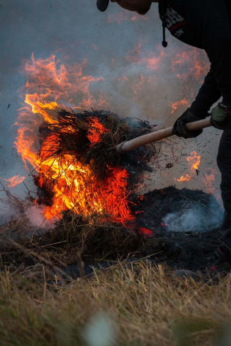 man-with-pitchfork-in-burning-hay