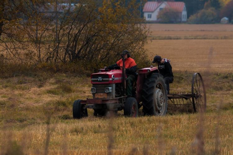 men-on-tractor-in-field