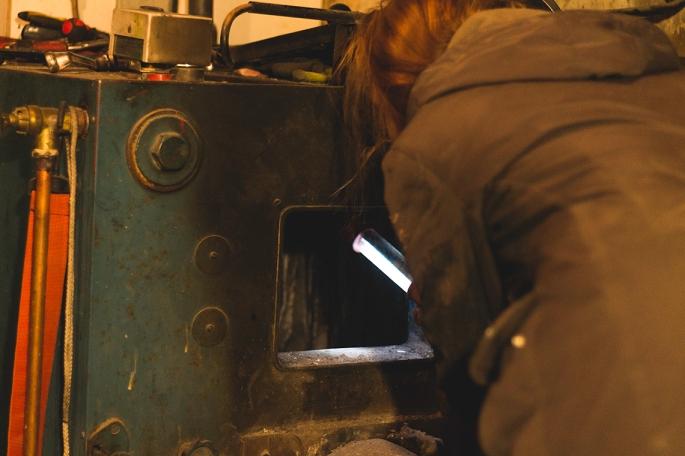 checking-the-wood-burner-chamber