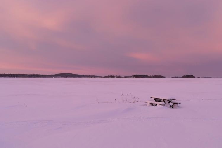 picnic-table-by-frozen-lake